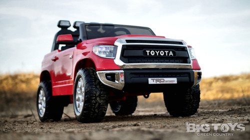 Red Tundra front passenger side view