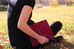 Stylish 10'' tablet sleeve made with purple wool felt from Nepal