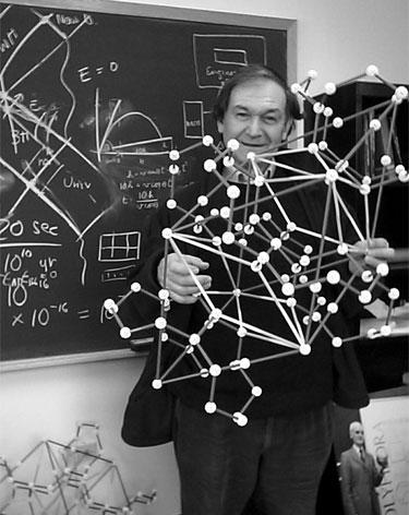 Roger Penrose holding a quasicrystalline structure