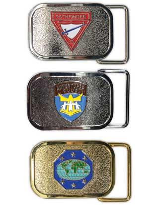 "Belt buckles for Pathfinders, Adventurers, and Master Guides. The colorful emblems on the belt buckles are raised and printed in full color. Dimensions: 2.25"" by 1.5"".  These buckles fit any leather belt with pre-drilled holes for fastening the belt prong and a snap-on closure to which the buckle can be attached. Buckles will look best on leather belts that are 1.25"" wide or just slightly wider.  Leather belt not included."