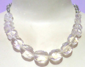 """Clear crystal necklace; 10-12"""" in length. Made in India."""