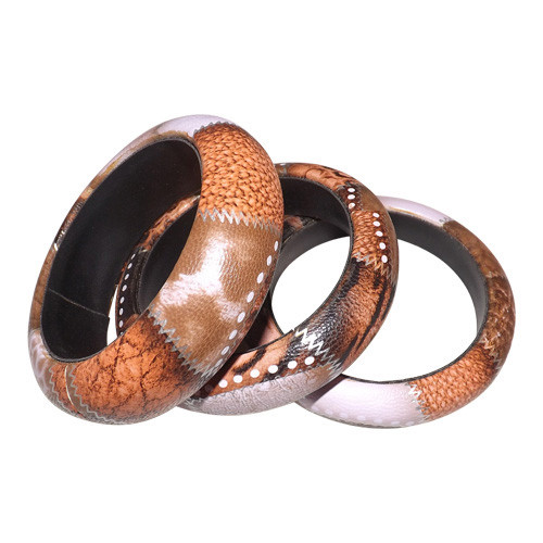 Animal Print Faux Leather Bangles  Faux leather material; animal print. Made in India.