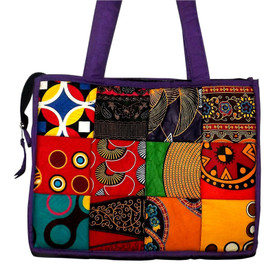 "Color Block African Print Tote Bag  Color block African print tote bag features various African fabric prints; 15"" width, 11"" length, 13"" shoulder drop; padded interior and interior pocket; zippered closure."