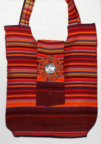 "Kikoy Maasai Tote Bag  Stylish Maasai tote bag can be used for the beach or daily practical use; added beauty of the popular maasai beads and engraved metal pendant of one of Africa's popular safari animals.  15x13x13. Strap drop is 9"", lined bag; interior pocket and zips close at the top.   Made in Kenya."