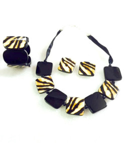"""Zebra Necklace Set Necklace is adjustable from 22-24"""" circumference, earrings are 1.5"""", and bracelet is elastic to fit any size wrist. Silk tie closure."""