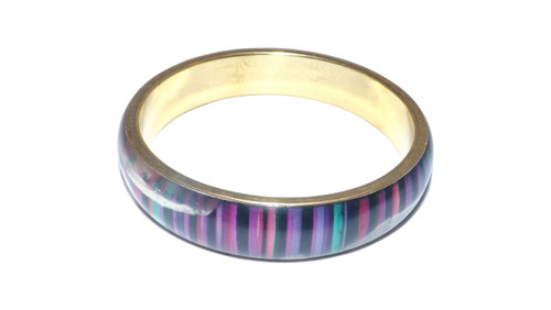 Black Multi-Colored Bangle  Girl's black multi-colored acrylic bangle....brass interior. Made in India.