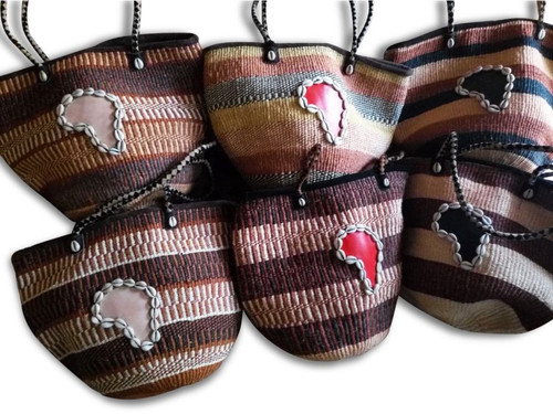 "Africa Map Cowrie Shell Large Sized Sisal Hand Bags  Woven handmade sisal fiber bag adorned with cowrie shells in Kenya in earth tone shades; fiber straps. Color patterns may vary from actual photo.  Leather map is on one side only,  lined and with zipper closure, Approx 17""W x 13T"" x 13D"".  Straps are 11"" long.   Please select a bag based on color of the map in center."