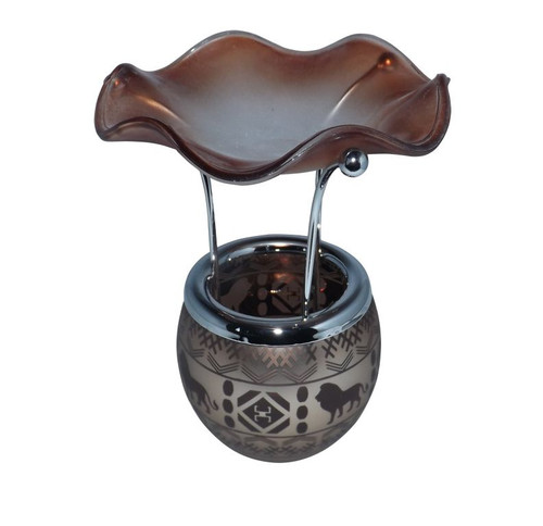 "Safari Print Oil Warmer  Brown/Bronze colors; features lion prints on the metal; nice center piece for your coffee table; stands 6"" tall. Will require tea light candle."