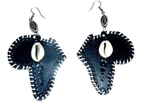 "Leather Cowrie Shell Earrings  Beautifully handmade leather cowrie shell earrings adorned with cowrie shells.  Mix of various shapes and styles all with cowrie shells and silver beading. 3"" sized handmade leather earrings."