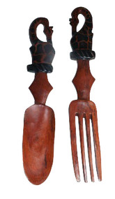 """12"""" African Safari Animal Wooden Salad Set  Various safari animal prints, handmade in real wood...treat with care.  Prints are on one side only.   Wood care  Always hand wash wood utensils with soap and warm water. The harsh detergent and heat in the dishwasher will wreck the wood in just a few cycles. Dry wooden spoons with a towel instead of letting them air dry. Residual moisture from washing will get absorbed into the wood, causing the wood to swell and crack over time. Once a month or so, rub in a little mineral oil with a soft cloth and let it sit for a few hours. Mineral oil is a food safe product that won't go rancid the way olive oil or other cooking oils would. It gets absorbed quickly, leaving wooden handles smooth but not greasy."""