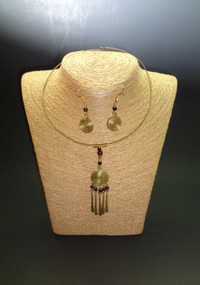 """Brass Kenyan Choker Set Choker is 10"""" in circumference, 3.5"""" pendant, and 1' earrings. Styles vary, photo is illustrative only. Made in Kenya."""