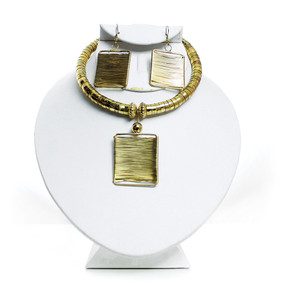 """Golden Goddess Jewelry Set  Regal and bright, this Golden Goddess Jewelry Set is a distinctive way to accessorize any ensemble. It will bring out the inner goddess in every woman. The necklace features a thick, torque-style necklace with a large, square pendant hanging from it. Comes with matching earrings. The necklace fits up to a 16"""" neck with an adjustable gap for larger sizes. The earrings are 2"""". Made in India."""