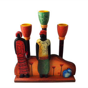 "Family Wooden Candle Holder  In brilliant colors and distinctive form, this African-inspired candle holder will hold 3 tapers with worldly style. Wood painted with a crackle finish.  8 "" x 2 3/4"" x 8 1/2"" high all wood."