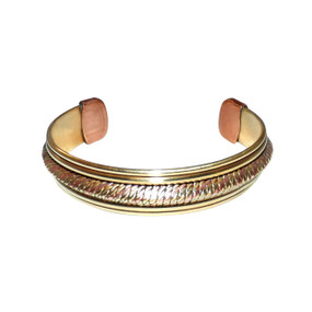 "Tri-Tone Braided Gold Bracelet  Thick tri-tone bracelet features a braided weave pattern.  Measures 6.5"" from end to end. Made in India."