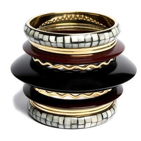 "Black & Gold Multi Stack Bangle Set  This multi stack set of bangles will complete your outfit Textures vary in the set. This set has 11 pieces. 2 5/8"" opening."