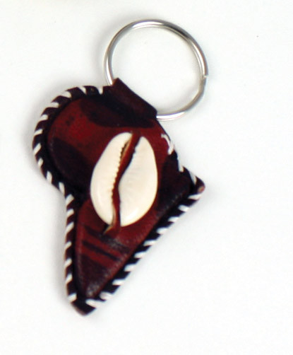 "Leather Africa Map & Cowrie Shell Key Chain Holder  2""....Handmade in Kenya.  Bring Africa Everywhere  Show your love of the motherland with this leather Africa key chain. Adorned with a genuine cowrie shell and accented with burned designs for a truly authentic look. 2"" big. Made in Mali."
