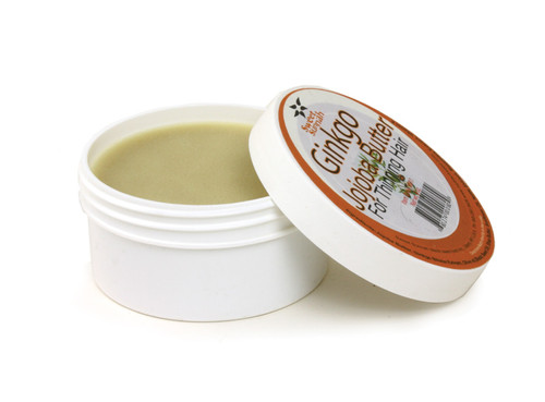 Ginkgo Jojoba Butter - 4 oz. Promote hair growth and reduce hair loss with the natural healing properties of jojoba oil, olive butter, black seed oil, beeswax, shea butter and vitamin E. This powerhouse of healing works to not only increase hair growth, but to soften and nourish hair, while reducing itchy, irritated scalp and dandruff. Love it on your hair? You can use it on your skin too! These nutritional ingredients also work to soften, soothe, and heal dry skin. Made in the USA with African ingredients. 4 oz. Ingredients: Jojoba Oil, Olive Butter, Black Seed Oil, Bees Wax, Sunflower Oil, Shea Butter, Vitamin E Oil, and Almond Oil.