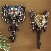 "Tribal Elephants-Set of Two-8"" Inches Beautifully adorned elephant wall art. ""7"" inches in height; the photo is blown up to show details. Made of Resin with dark brown painted finish."