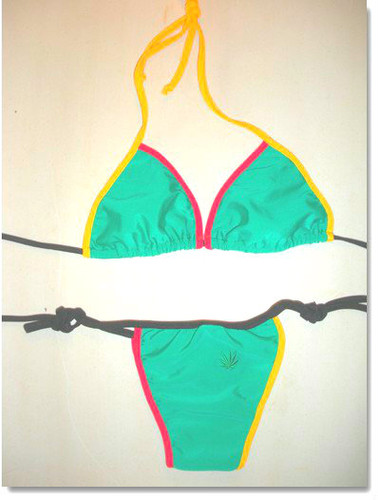 Green Rasta bikini, Brazilian cut in red, green, yellow or black with Rasta trim. Sizes S, M, L. Nylon Fabric.