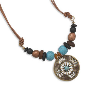 "Multi-bead Leather Fashion Necklace. 18"" + 2"" extension double strand brown leather fashion necklace with horn, wood, resin, gold tone and glass beads. Pendant is 39 mm in diameter."