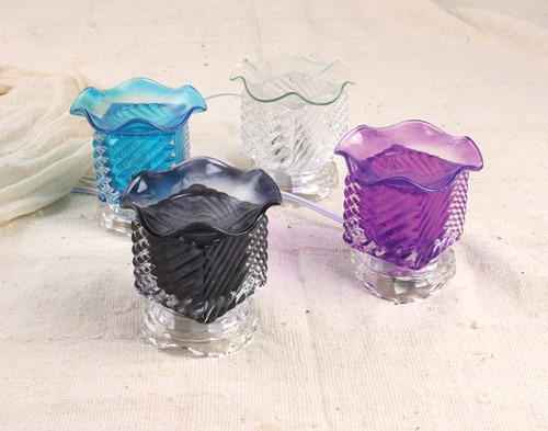 """Electric Oil Burner  Sit and embrace the warmth. Create a whole new atmosphere with these electric oil burners. You can adjust the lighting on each one for a hint of a glow, or bright light. Choose from different colors. 5"""" tall. Made in China."""
