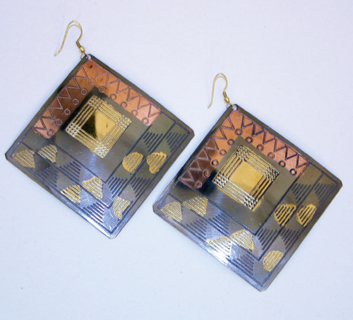 "Heavy Metal Tri-ToneEarrings Go bold with these brass, silver, and copper-colored square earrings. 2.25"" diameter for a look that can't help but capture attention. Made in India."