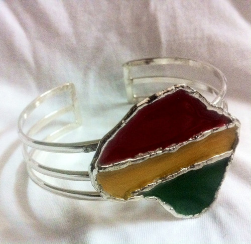 """Africa/Rasta Map Bracelet Sets  Set features a Silver over Brass cuff style bracelet with a matching adjustable ring.  Cuff bracelet has a 1"""" opening.   Two styles available in either: Rasta or Africa"""