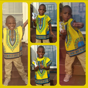 "This little brother is 42"" tall and is wearing the yellow dashiki top in a size Medium."