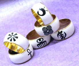 "Adinkra Bangles   Ancient Afrikan symbols!! Select a design that has a special meaning for you or a loved one! Brass finished, acrylic outer-layer.  Opening is 2 7/8""."