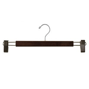 This flat pant and skirt wooden hanger coated in a clear varnish for durability. It has adjustable non-staining clips for hanging and a chrome swivel hook and chrome bar