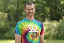 "Our ""Peace.Love.Twins"" tie-dye adult twin parent tee is super soft and bursting with color. Features our logo on the back neck line in white ink."
