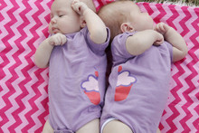 """Our """"Cutest Little Cupcake"""" twin bodysuit set features half of a cupcake on one bodysuit and half of a cupcake on another tee so that when the twins are together they form the Cutest Little Twin Cupcake!"""
