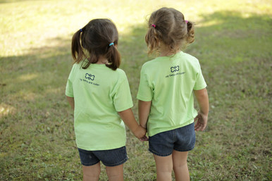 "The back of our twin toddler ""2 Cute"" t-shirt features our logo in a dark navy ink."