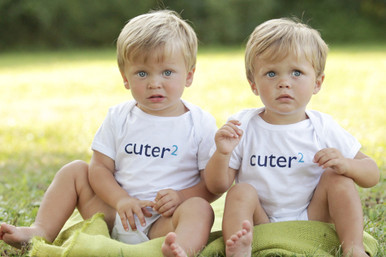 """Our """"Cuter Squared"""" infant twin set has the word cuter in a dark navy ink and 2 in either blue or pink. Perfect twin baby bodysuit set."""