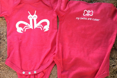 "Our twin ""Clever Crab"" bodysuit set has a distressed white ink on a vintage red tee with logo on the back. twin baby bodysuit set."