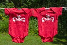 "Our twin baby bodysuit set. Our ""Clever Crab"" with a distressed white ink on a vintage red bodysuit."