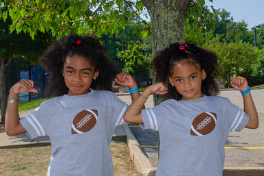 """Our My Twins Are Cuter infant """"Fun Football"""" twinset is super soft. We placed a football on the front of the twin set with our signature #2 as the laces. The My Twins Are Cuter logo is on the back at the neck line."""