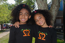 "Our My Twins Are Cuter toddler ""Spooky Pumpkin"" twinset is super soft. Our Jack-o-lantern is designed with our signature number 2 and the My Twins Are Cuter logo is on the back at the neck line."