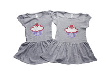 Our twin Cutest Little Cupcake on the sweetest heather grey dress. 2 sweet to have just 1 that's why are made for twins. Can you find our signature number 2's in this design?