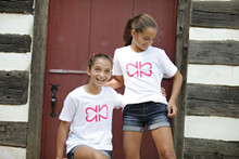 "My Twins Are Cuter ""Original"" youth tee with our logo, made of 2's, on the front."