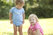 "Our ""Cuter Squared"" infant twin set has the word cuter in white ink and the number 2 in dark navy ink."