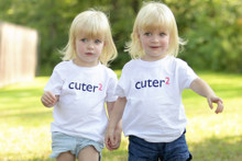 "Our ""Cuter Squared"" twin toddler t-shirt set has the word cuter in a dark navy ink and the number 2 in pink ink.  Cuter2!"