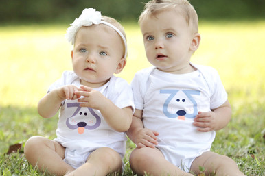 "Our twin ""Playful Puppy"" infant twin set. This Playful Puppy is designed with our signature number 2 giving it double the cuteness!"