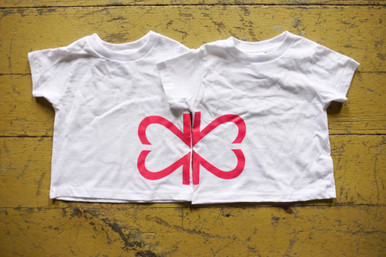 """Our soft white """"Side By Side"""" design features half of our logo on one toddler tee and half of our logo on the other toddler tee."""