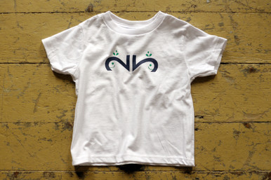 "Our twin ""Whimsical Whale"" toddler tee features a whale designed with the number 2, of course in dark navy ink with a green spray."