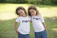"""Our twin """"Whimsical Whale"""" youth tee features a whale, designed with the number 2, of course in dark navy ink with a pink spray."""