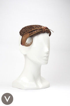 Vintage 1950s bronze sequin covered cocktail hat with bow detailing and feather trim