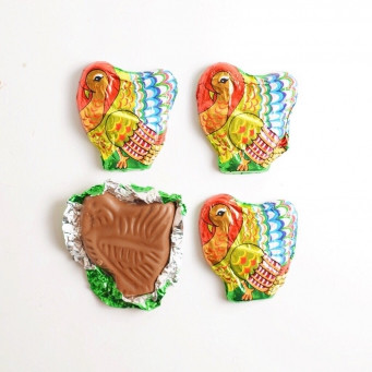 Highly detailed, solid premium milk chocolate turkey wrapped in colorful Italian foil.