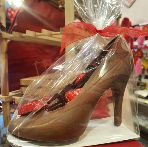 Milk chocolate shoe filled with assorted chocolates.