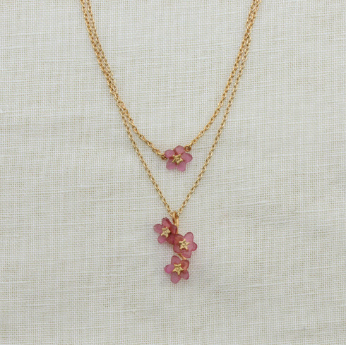 """Michael Michaud Design. Bronze accented in 24K gold and cast pink glass. With 18"""" double layer chain. Handmade in USA."""